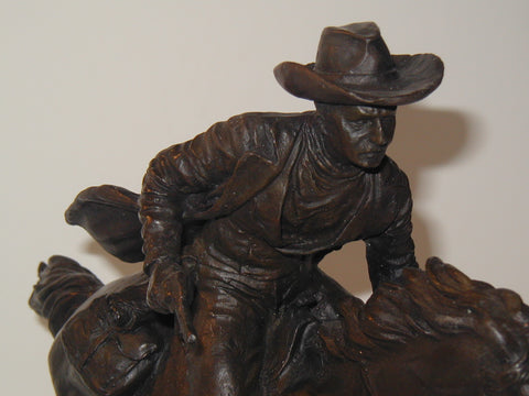 "After Alfred Barye (French 1839-1882), ""Pony Express Rider"", a patinated bronze figural group, signed, ca. 1870"
