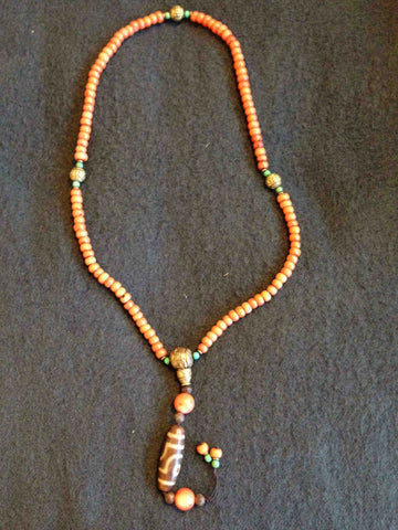 Tibetan Red Coral Necklace with Dzi Bead Pendant, with additional turquoise and gilt metal beads