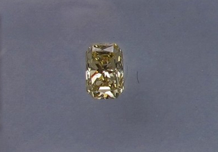 Modified Brilliant Cut Natural Fancy Yellow Diamond 0.31 ct., SI2 clarity, cut-cornered rectangular shape</p>
