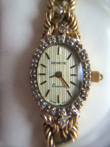 Ladies Swiss 14K Yellow Gold and Diamond Wristwatch, Geneva, ca. 1970-80, with 14k yellow gold twisted rope bracelet