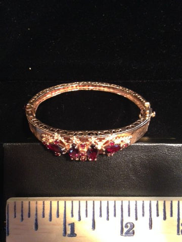 14K Yellow Gold and Garnet Hinged Bangle, mid-20th century
