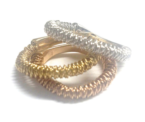 Three Orlando Orlandini 18K Tri-Color Gold Bands, one each of yellow, white and rose gold, contemporary