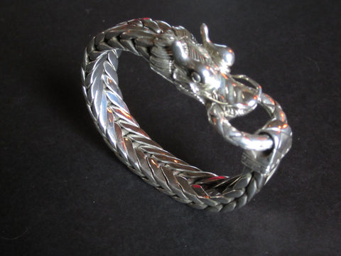 Men's American Silver Dragon Head Reticulated Bracelet, designed by Guy Bedarida, manufactured by John Hardy, from the Naga Collection, 21st century