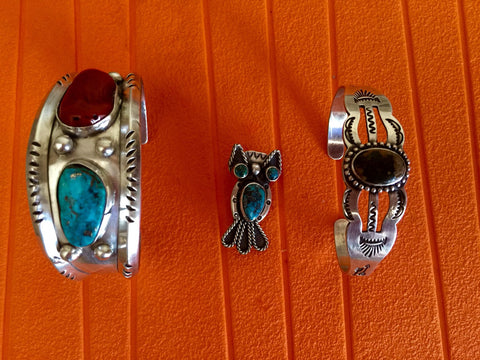 Two Native American Silver Cuff Bracelets and an Owl-Form Brooch, 20th century