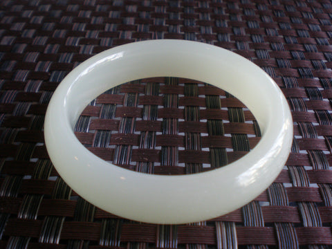 Chinese Carved Mutton Fat Jade Bangle, 20th century