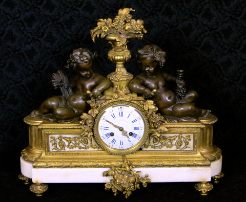 French Louis XVI Style Gilt Bronze and Marble Mantel Clock, retailed by J.B. Marchand, Rue Richelieu, Paris, ca. 1880-90