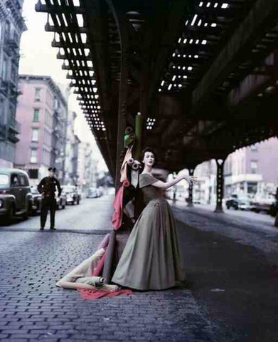 William Helburn (American, 20th Century), Dovima Under the El (Dior Creates Cosmopolitan Drama), 1956, signed