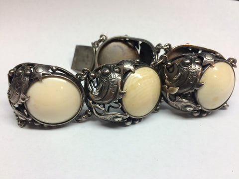 Mid-Century Modern Danish Silver Parure, made by Niels Eric, ca. 1950, comprising a brooch, earrings, and bracelet