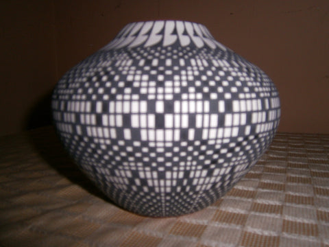 "Melissa Concho Antonio (Acoma Pueblo, b. 1965) ""Eye dazzler"" black and white painted red clay pottery jar, last quarter 20th or 21st century, signed"