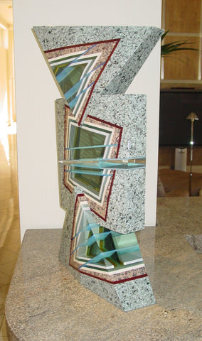 "William Carlson (American, b. 1950), ""Praganz"", 1992, signed, granite, optical glass, and dichroic glass, laminated"
