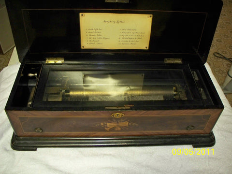 Swiss Music Box with Burl Walnut Fruitwood Inlaid Case, one cylinder, playing twelve songs, late 19th century