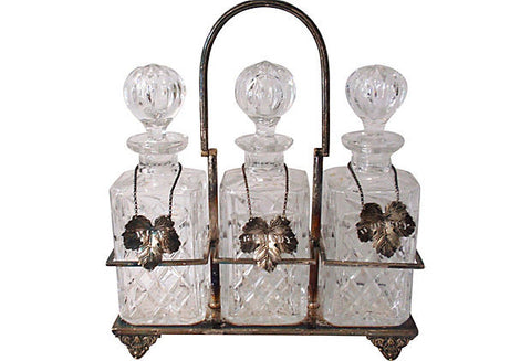 Set of Three Cut Glass Decanters in Silver Plate Carrier