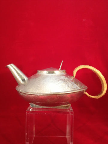 "English Hammered Pewter and Rattan ""Tudric"" Teapot, designed by Archibald Knox (1864-1933), ca. 1903-4, retailed by Liberty & Co."