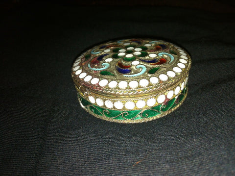 Russian Parcel-Gilt Silver and Enamel Circular Snuffbox, St. Petersburg, 20th century, and a Russian Silver Mezuzah, Moscow, 1873