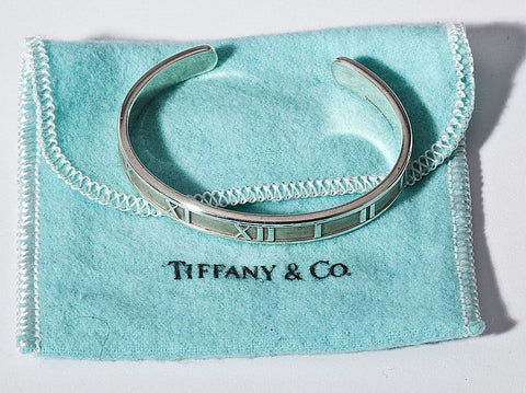 "Tiffany & Co. Silver ""Atlas"" Cuff Bracelet and Hoop Earrings, late 20th century/early 21st century"