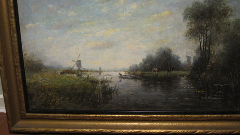 Willem Abraham Wassenaar (Dutch, 1873-1956), Dutch river landscape with a windmill and cows, oil on canvas, signed