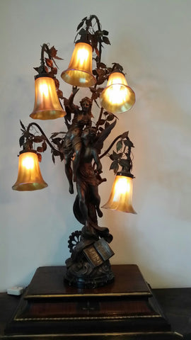 French Patinated Spelter Five-Light Figural Lamp with 6 Quezal Shades, ca. 1900, signed illegibly