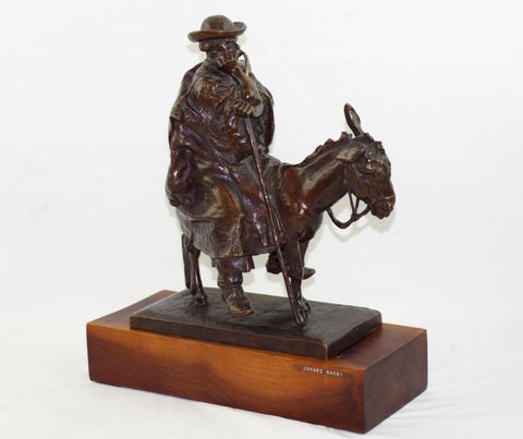 Jozsef Rona (Hungarian, 1861-1939), Rustic Seated on a Donkey, patinated bronze figural group, signed
