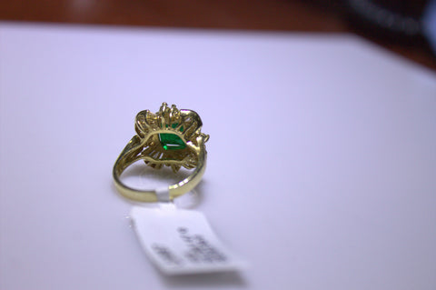 14K Yellow Gold, Diamond and Emerald Ring, with 2.06 ct. square cut emerald and 1.47 ct. round and baguette cut diamonds