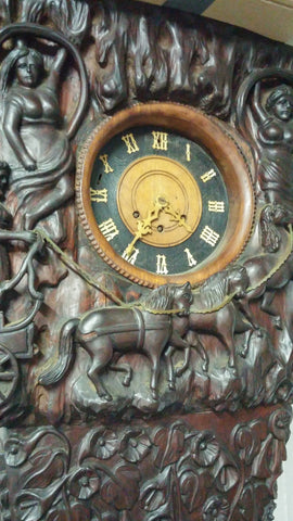 German Black Forest Style Carved Chiming Longcase Clock,  the case likely later 20th century, movement late 19th century