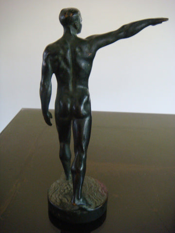 After Maurice Guiraud-Riviere (French, 1881-1947), Le salut de l'athlete, patinated bronze, signed in the cast, Etling foundry