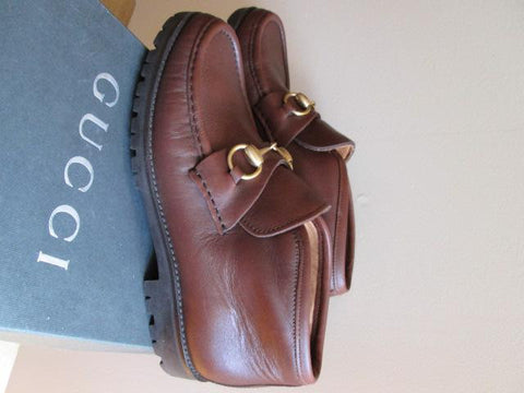 Pair of Gucci Brown Leather Loafers, 20th/21st century, with brass hardware