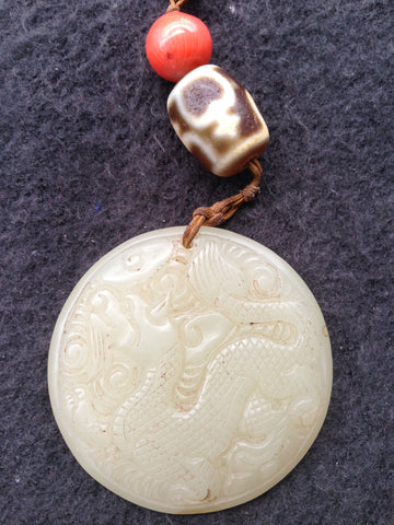 Sino-Tibetan Nephrite, Red Coral and Dzi Bead Pendant, early 20th century
