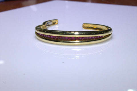 18K Yellow Gold and Ruby Bangle, 20th/21st century