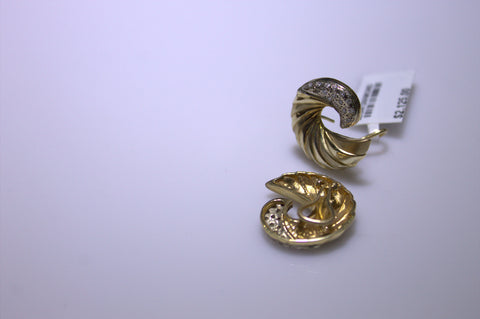 Pair of 14K Yellow and White Gold and Diamond Ear Clips,  20th century