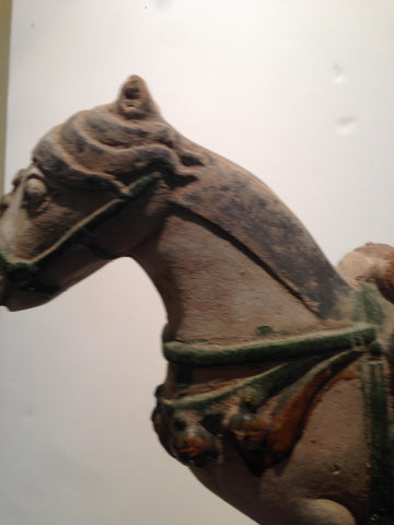 Chinese Pottery Funerary Model, Caparisoned Horse probably Ming Dynasty (1368-1644), with green and amber lead glaze