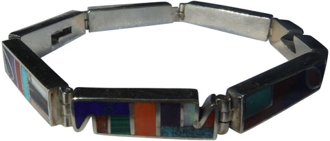 Franklin Carrillo (American/Laguna Pueblo), Silver bracelet inlaid with semi-precious stones, marked, 20th century