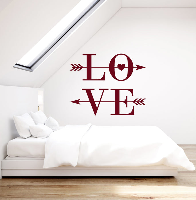 arrows as wall art in bedroom