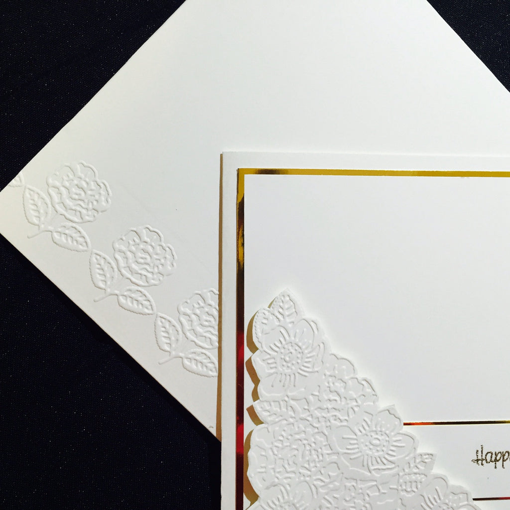 Classic embossed roses in cream and gold