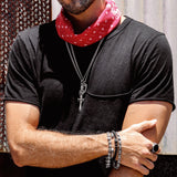 man in black shirt with sterling silver jewelry and red bandana