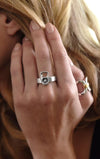 woman wearing sterling silver rings