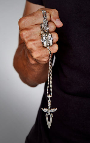 man wearing sterling silver king baby jewelry