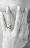 woman wearing 18k gold king baby ring