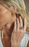 woman wearing king baby 18k gold earrings