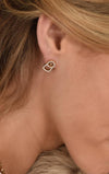 woman wearing king baby gold earrings with diamonds