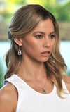 woman wearing king baby sterling silver earrings with 18k gold