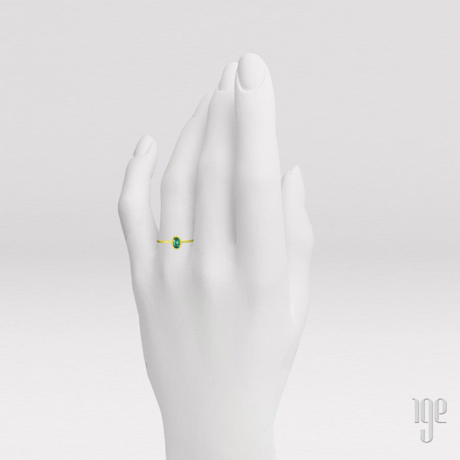 Petra Class Faceted Oval Emerald Ring