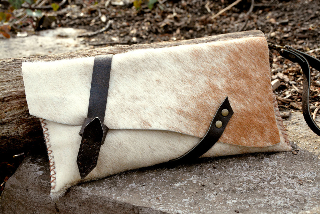 Natural cowhide clutch with wrap around strap SOLD