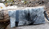 Cowhide clutch with wrap around strap