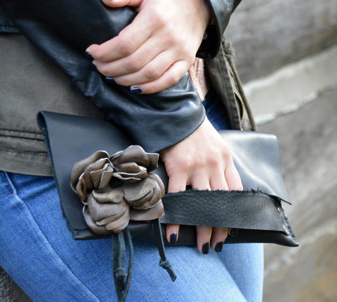 Black evening bag with leather flower