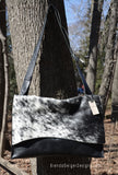 Black and white cowhide messenger style bag