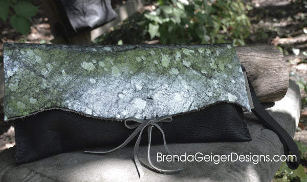 Silver metallic cowhide and Black leather clutch
