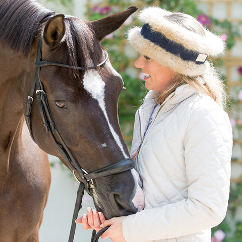 Charlotte Luxury Beige faux fur and navy reversible head-warmer as featured in Horse & Hound