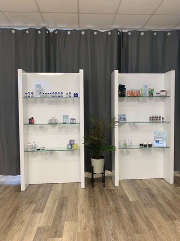 white store shelves with products displayed, gray background, wood floor