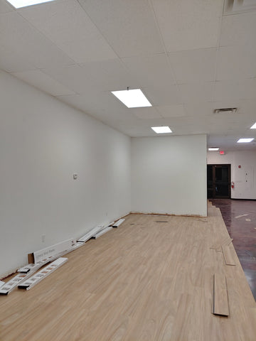 White ceiling, walls, wood flooring in progress