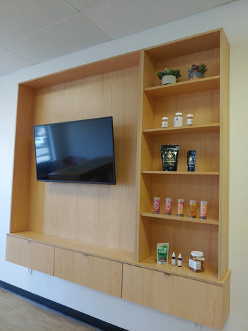 Wooden wall cabinet, television, shelves with items on them